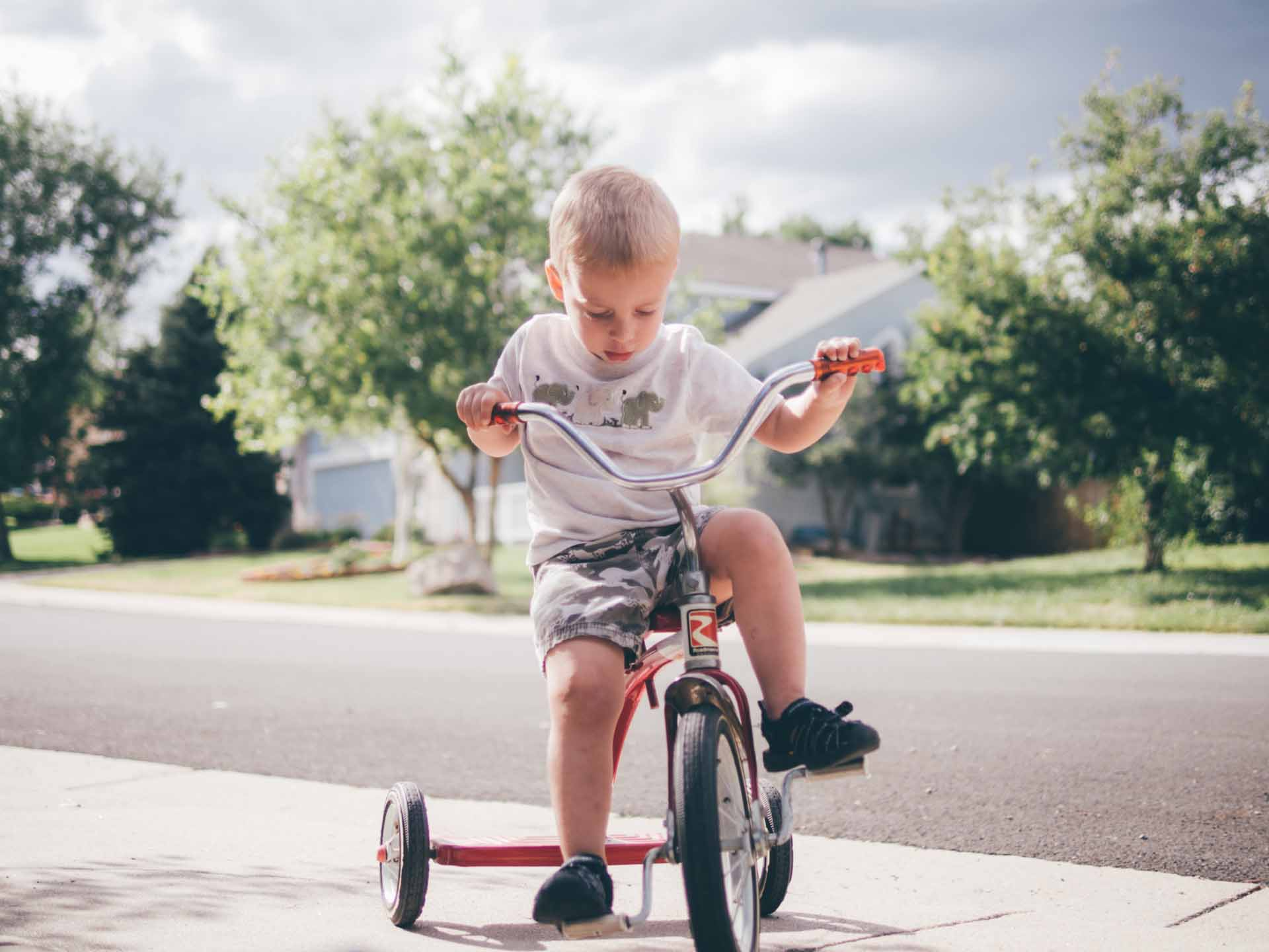 My son, Noah, learning to ride a tricycle at his grandparent's house in Colorado. Photo taken with the E-M10 and Olympus 75mm f/1.8 lens.