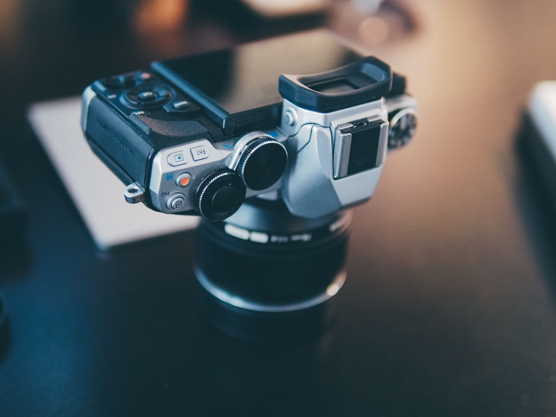 The E-M10 has two manual control dials which can control aperture, exposure, shutter, speed, and more. There are also two function buttons (Fn) that you can set to toggle any setting you want.