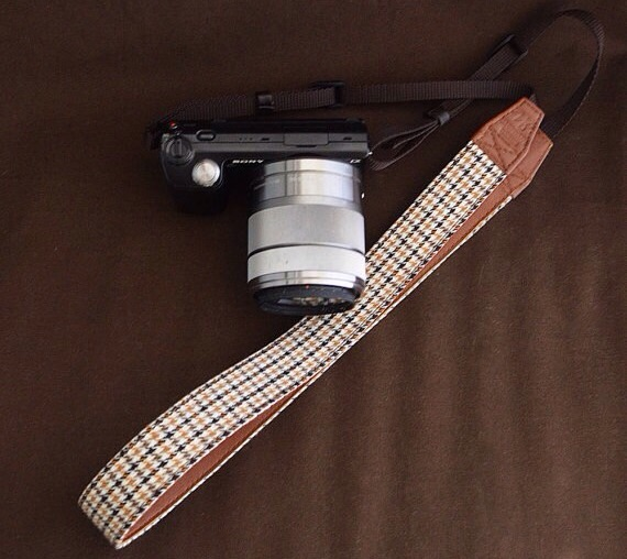Shoko Miyamoto's Handmade Camera Slings> on Etsy. ($29 + $3 intl. shipping)