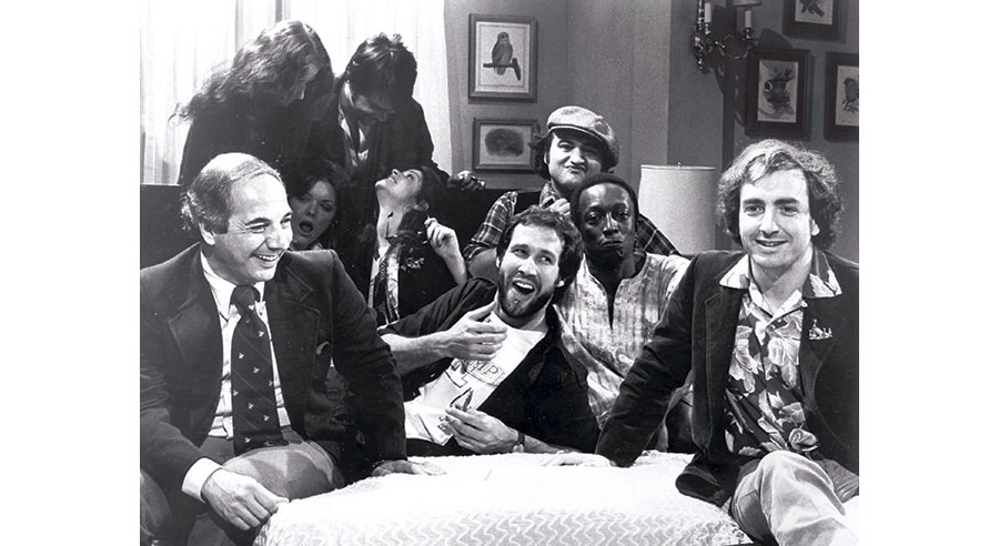 Lorne Michaels (right) with the cast of SNL (center) and White House press secretary Ron Neeson (left).