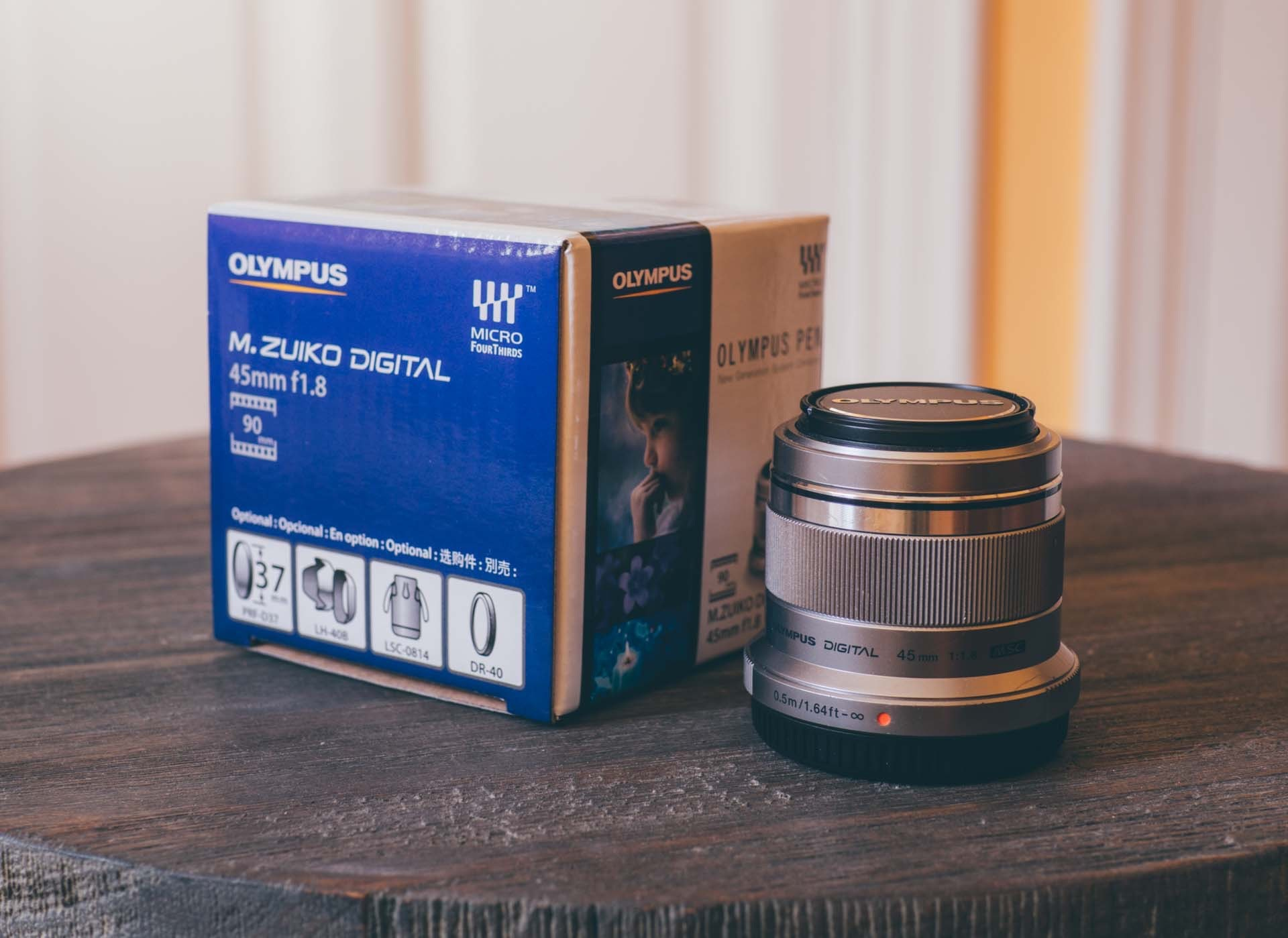 The Olympus 45mm f/1.8 telephoto lens. ($399)