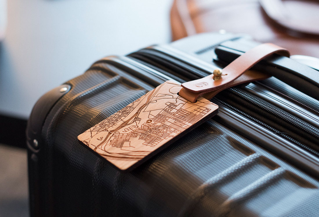 New Custom's wooden cartography luggage tag. ($69 per custom tag)