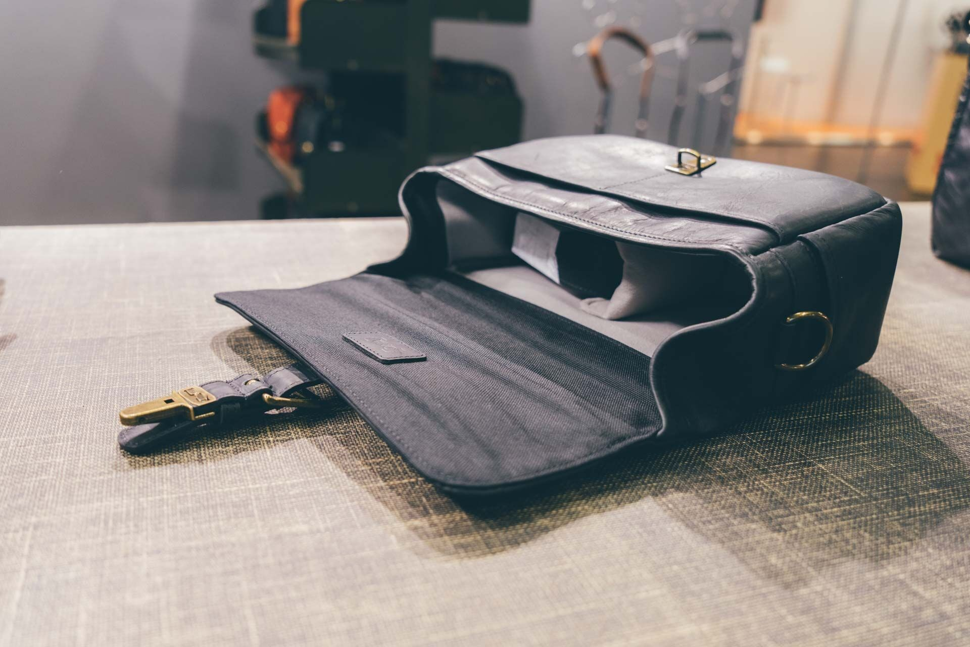 All of the new black leather bags feature black interiors with gray padded dividers.