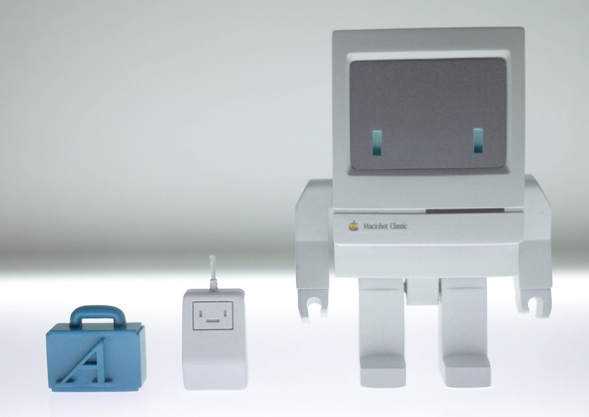 "Macinbot with its ""font suitcase"" and friendly mouse companion. More images and angles can be viewed here."