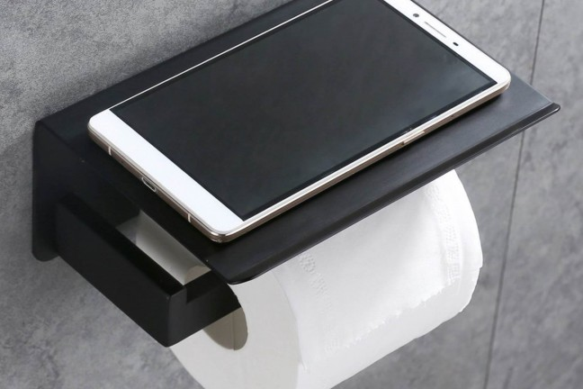 This toilet paper holder lets you set your phone (or whatever else) down while you're conducting your business. ($25–$30, depending on color)