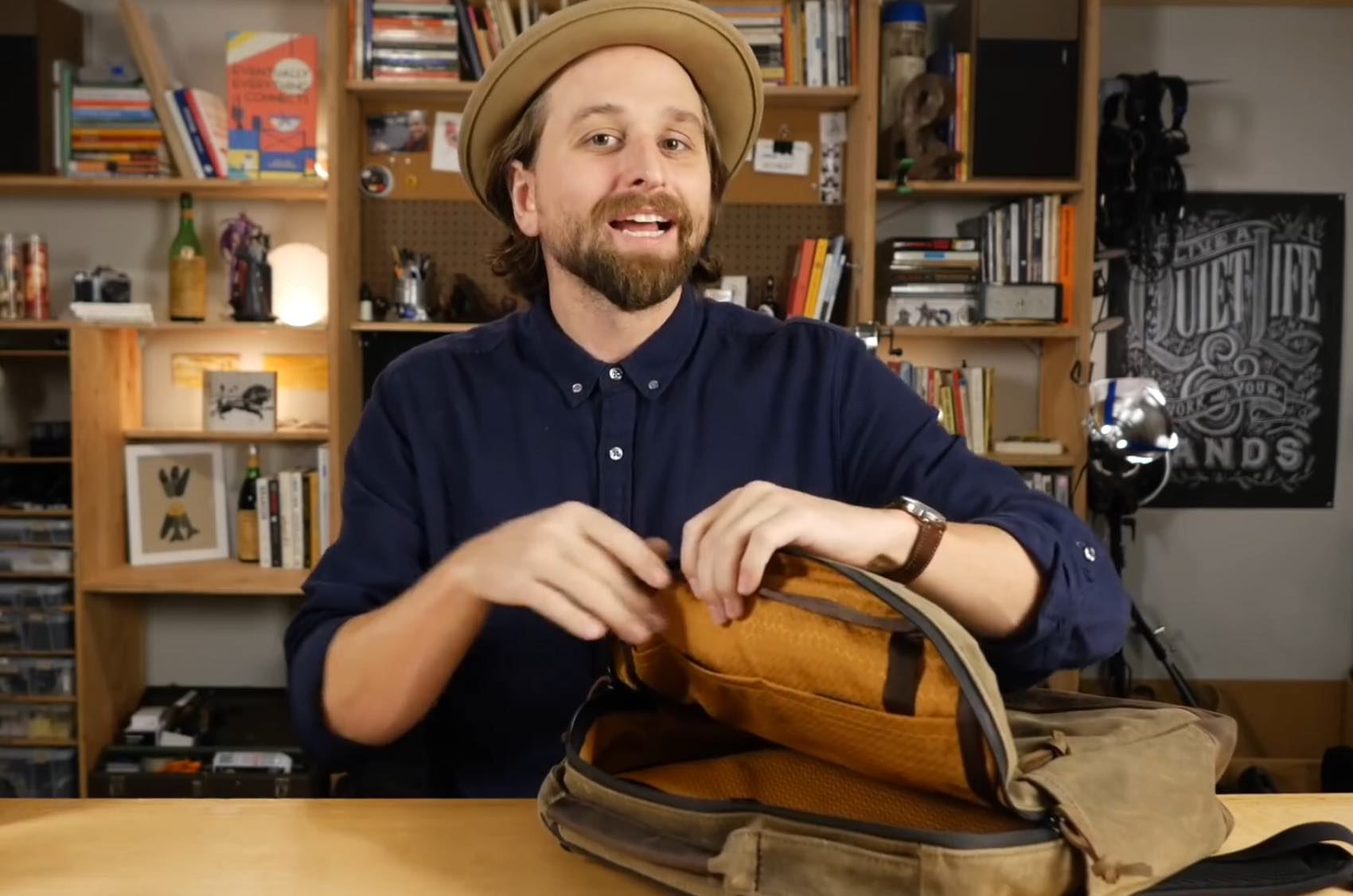 As Chase Reeves says in his video review, it's a little Indiana Jones on the outside and Louis Vuitton on the inside.