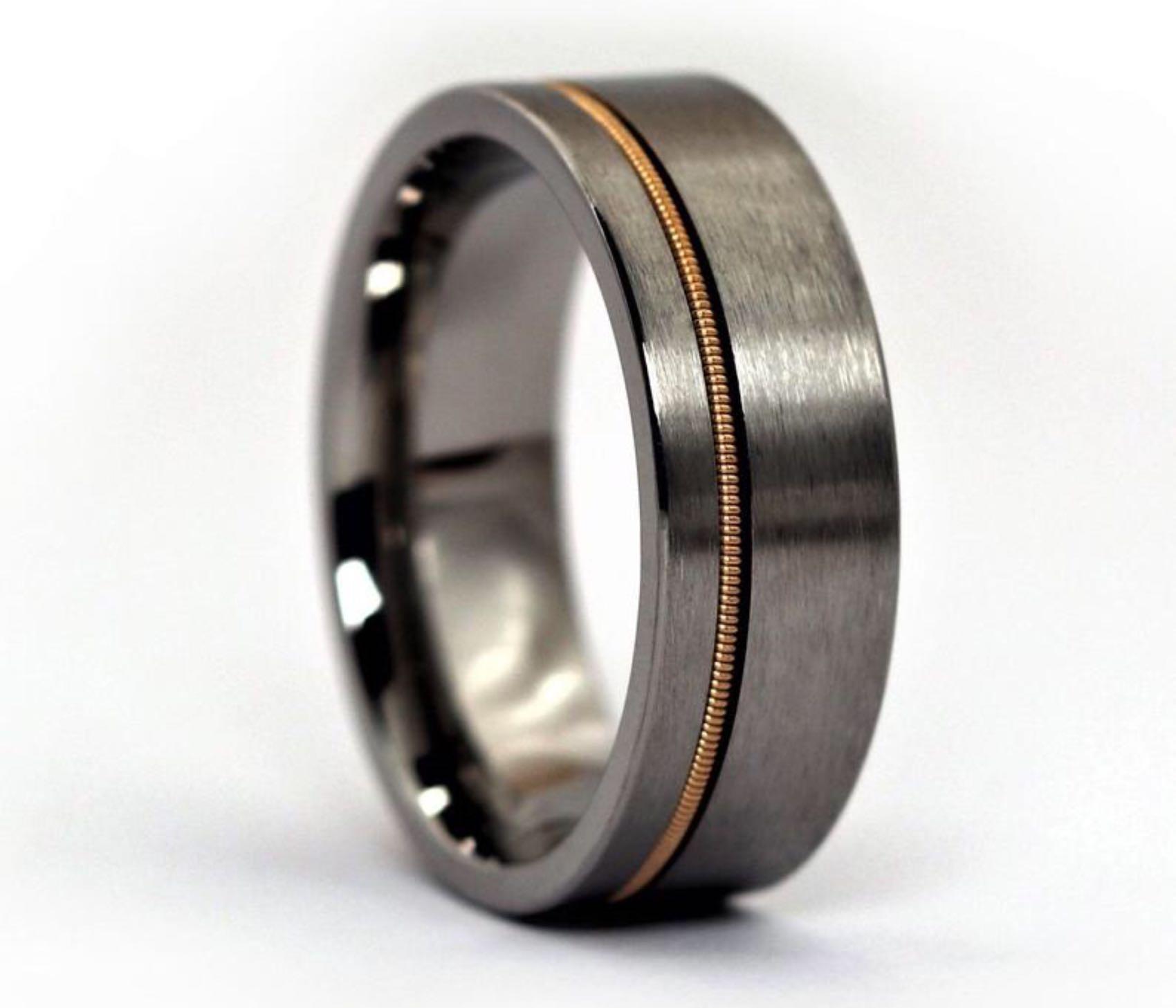 Anvil Rings guitar string ring. ($95 for black tungsten, $155 for titanium)