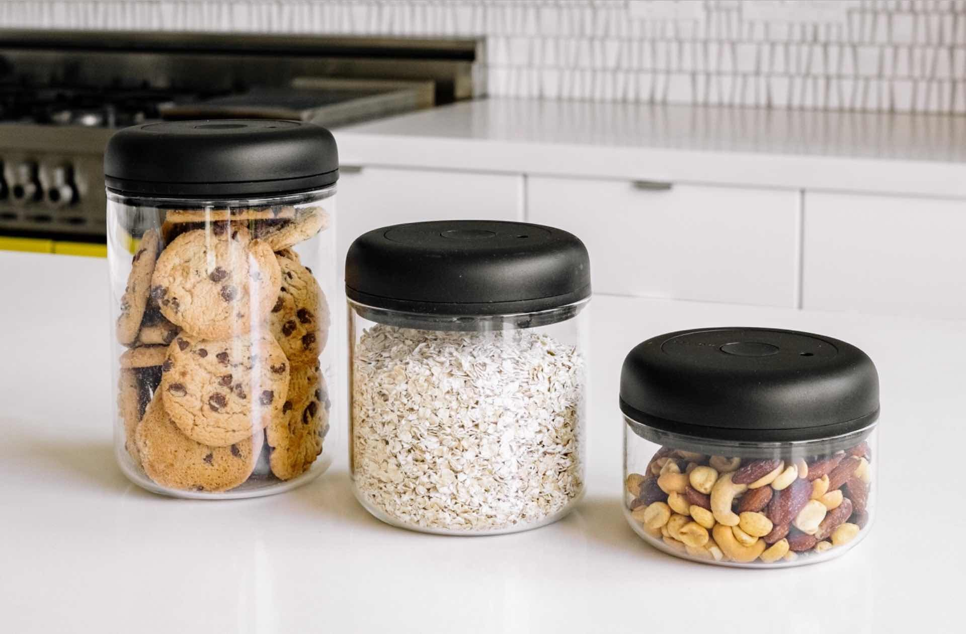 "Fellow ""Atmos"" vacuum food storage canisters. ($25–$35 per container, depending on size and color; available in matte black and clear glass)"