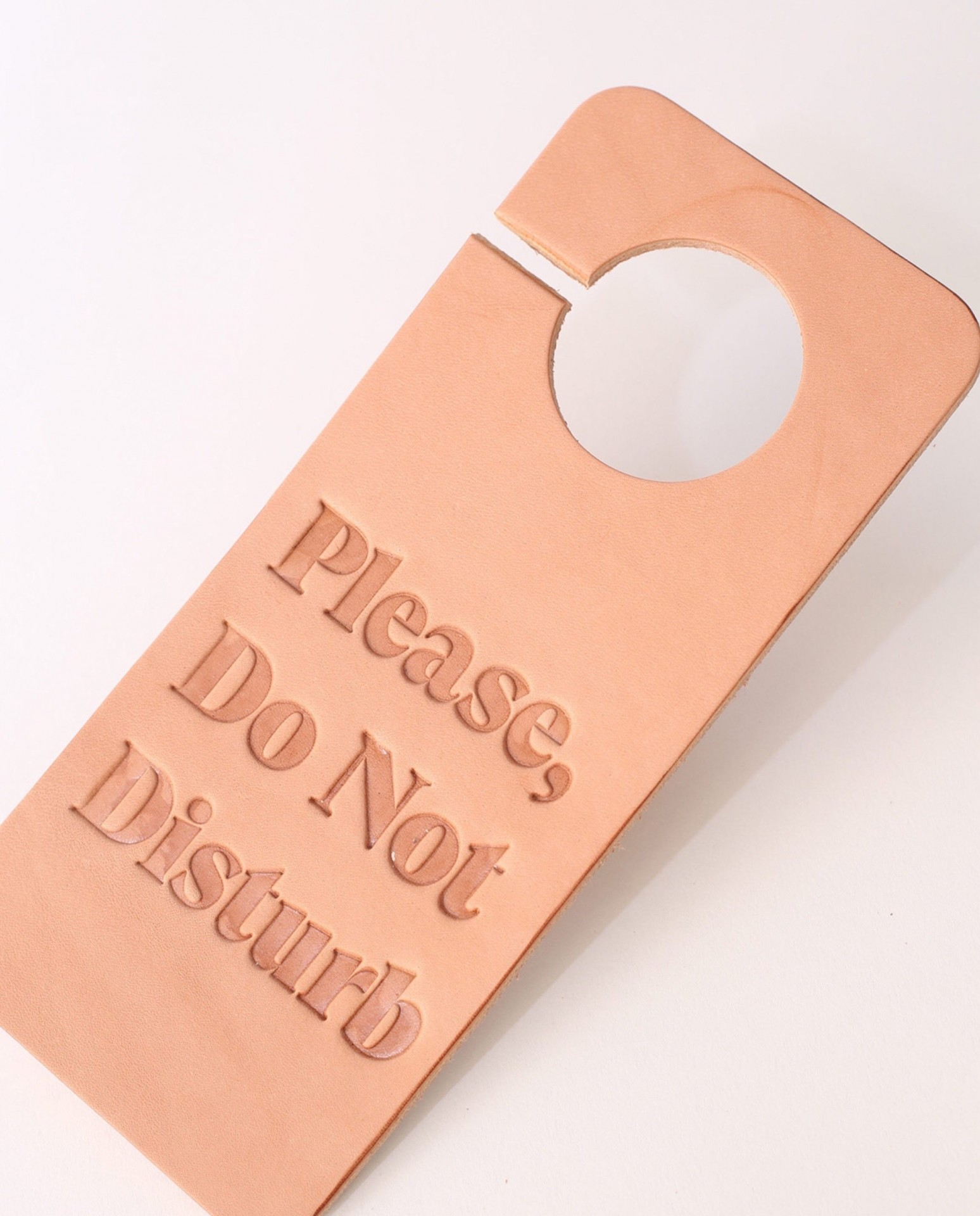 foxtrot-supply-co-do-not-disturb-leather-door-hangs-natural